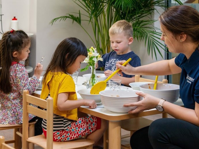 Kids are having healthy meal in childcare